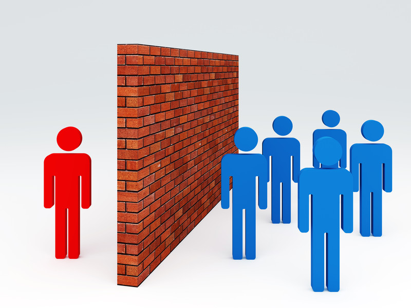 Individuals either side of a wall that represents a barrier to communication
