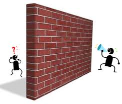 A wall between two individuals representing a barrier to their communication