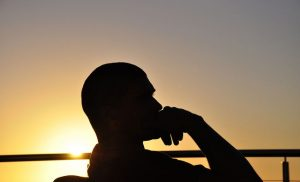 Silhouette of a man reflecting on activities