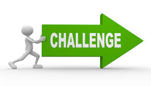 A person pushing a green arrow with the word 'challenges' on it