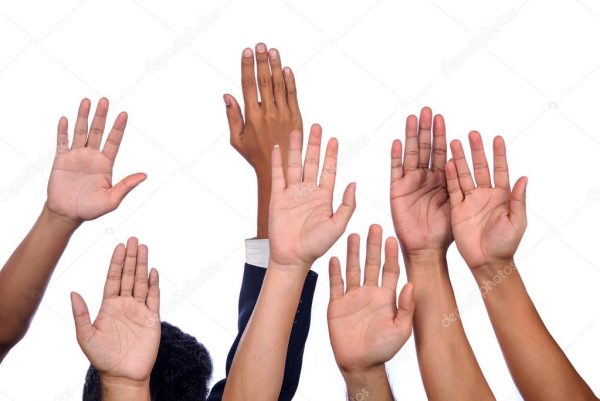 Several individual hands/arms raised in the air together representing Active Participation